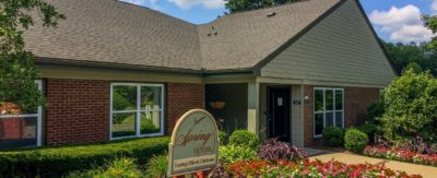 The clubhouse at Spring House Apartments in Lexington Kentucky, with beautiful blooming flowers.